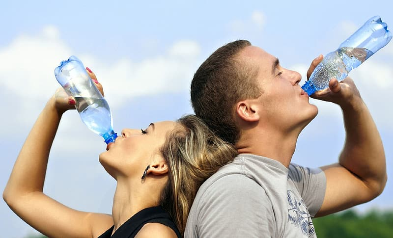 Woman And Man Drinking Bottled Water