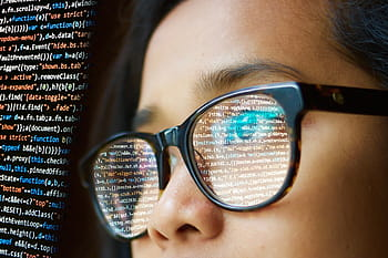 Woman Programming Glasses Reflect Royalty Free Thumbnail